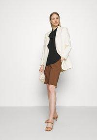 Marks & Spencer London - BLOUSE - Button-down blouse - black - 1