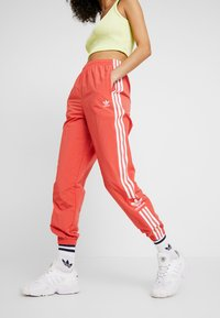 adidas Originals - LOCK UP ADICOLOR NYLON TRACK PANTS - Tracksuit bottoms - trace scarlet/white - 0