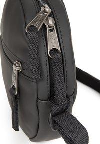 Eastpak - ADA - Across body bag - matte black - 4