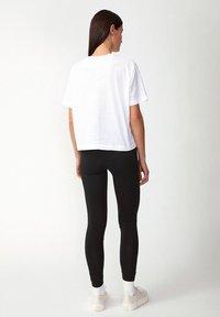 ARMEDANGELS - FARIBAA - Leggings - Trousers - black - 2