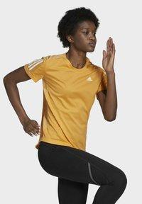 adidas Performance - OWN THE RUN T-SHIRT - T-shirt con stampa - orange - 4