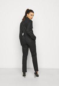 Missguided Petite - COATED CINCHED WAIST BOILERSUIT - Jumpsuit - black - 2