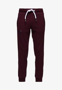 Superdry - LABEL CUFFED JOGGER - Tracksuit bottoms - bordeaux - 4