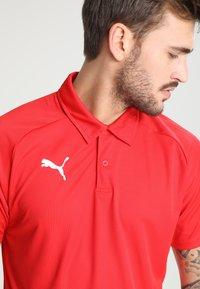 Puma - LIGA SIDELINE  - T-shirt de sport - red/white - 3