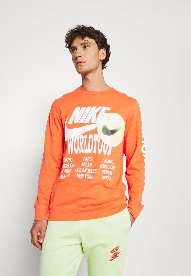 Long sleeved top - turf orange