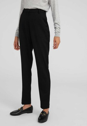 MAGDA - Trousers - black