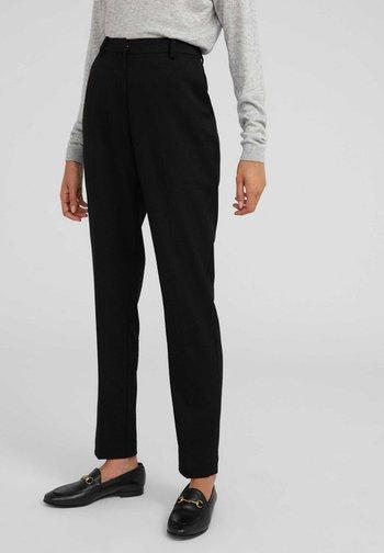 MAGDA - Trousers - black