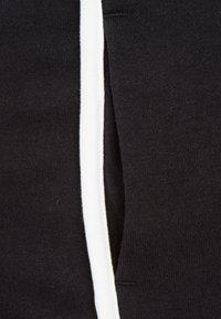Nike Sportswear - HERITAGE  - Shorts - black / white - 2