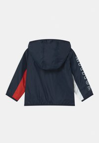 Tommy Hilfiger - BABY TOMMY COLORBLOCK UNISEX - Light jacket - twilight navy - 1