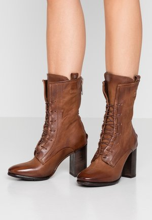 High heeled ankle boots - calvados