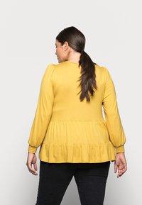 New Look Curves - TIER PEPLUM - Long sleeved top - dark yellow - 2