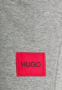 HUGO - Tracksuit bottoms - medium grey - 6
