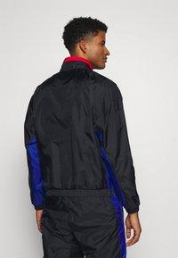 Nike Performance - NBA CITY EDITION TRACKSUIT - Tracksuit - black/rush blue/university red - 2