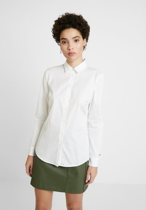 ESSENTIAL - Button-down blouse - classic white