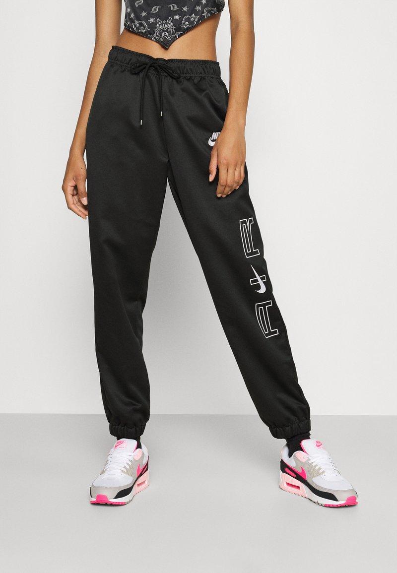 Nike Sportswear - AIR - Tracksuit bottoms - black/white