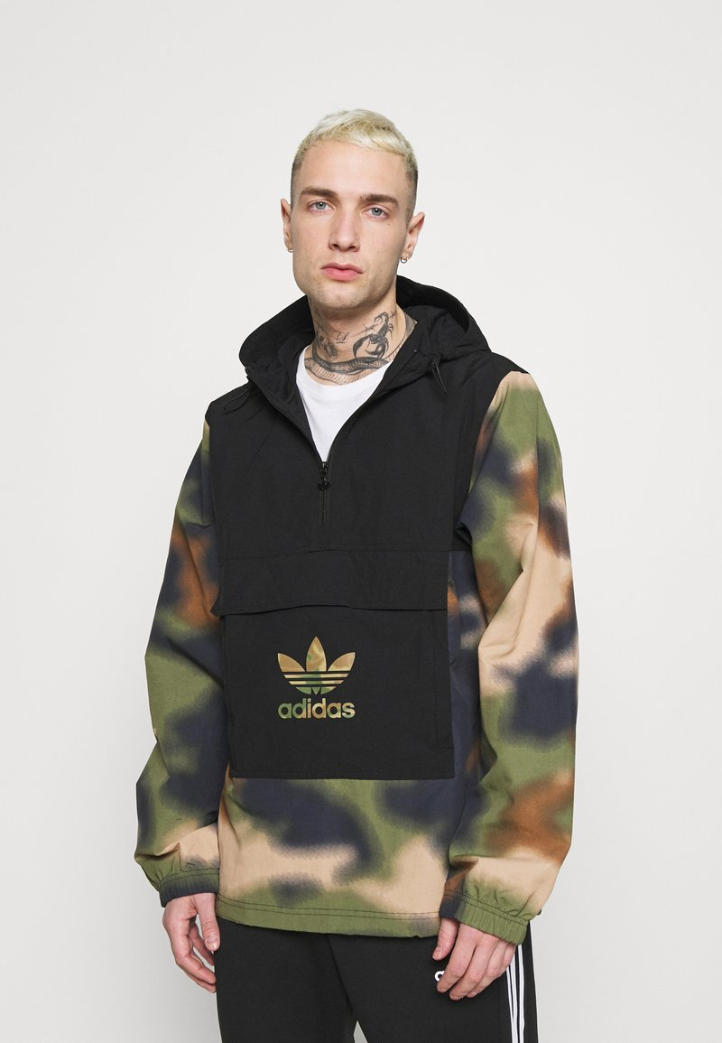 adidas Originals - CAMO WINDBREAKR - Summer jacket - hemp/multco/black