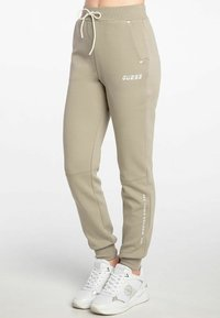 Guess - ABBY LONG  - Tracksuit bottoms - beige - 1