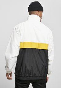 Starter - Summer jacket - white/black/golden - 2