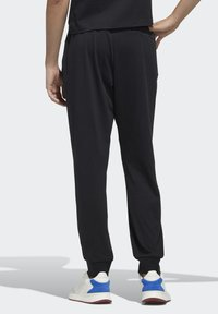 adidas Performance - ESSENTIALS JOGGER JOGGERS - Pantaloni sportivi - black - 5