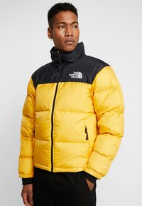 The North Face - Down jacket - yellow - 0