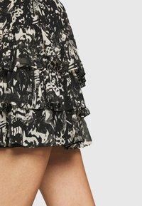 NIKKIE - RUFFLE SKIRT - Mini skirt - black - 3