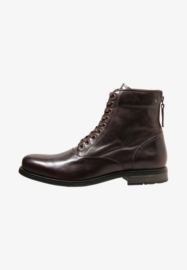 DELERIUS - Lace-up ankle boots - brown