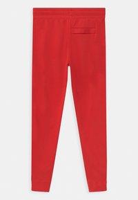 Nike Sportswear - Teplákové kalhoty - university red/white - 1