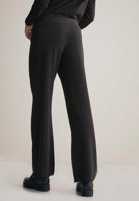Falconeri - PALAZZO - Trousers - black - 1