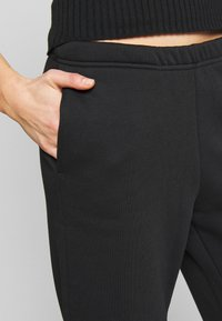 Gina Tricot - BASIC - Tracksuit bottoms - black - 4