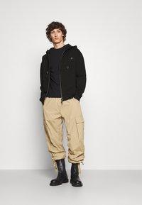 Vivienne Westwood - RUGGED ZIP HOODIE - Zip-up sweatshirt - black - 1