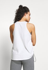 Under Armour - CHARGED TANK - Tekninen urheilupaita - onyx white/black - 2