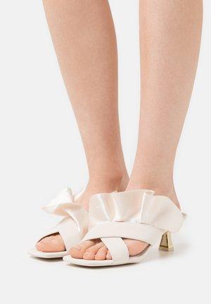 DIA - Heeled mules - white