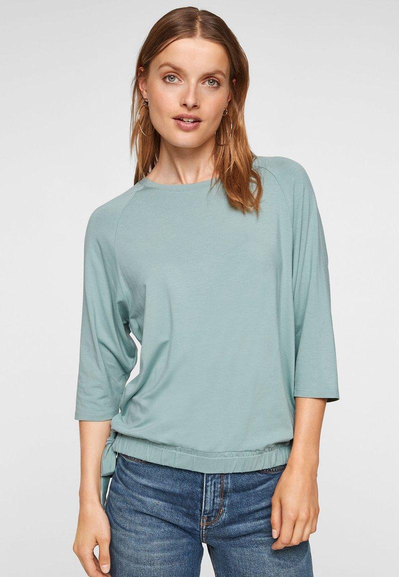 s.Oliver - À NŒUDS DÉCORATIFS - Long sleeved top - light green