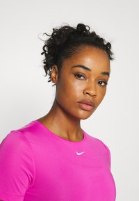 Nike Performance - ALL OVER - T-shirt - bas - active fuchsia/white - 3
