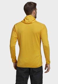 adidas Performance - TERREX SKYCLIMB FLEECE JACKET - Fleece jacket - yellow - 1