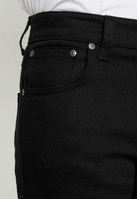 Nudie Jeans - GRIM TIM - Slim fit jeans - dry ever black - 3