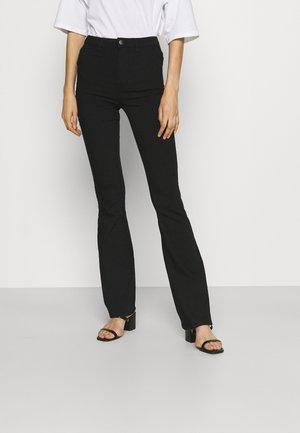 PCHIGHSKIN FLARED PANT - Trousers - black