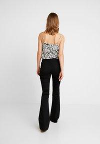 Ivy Copenhagen - CHARLOTTE SERIOUSLY - Flared Jeans - black - 2