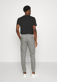 Tommy Hilfiger - ICON - Tracksuit bottoms - grey - 2