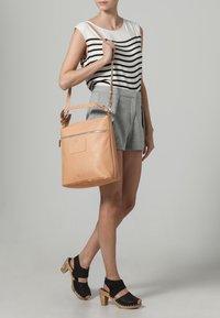Bree - STOCKHOLM HOBO - Handbag - nature - 1