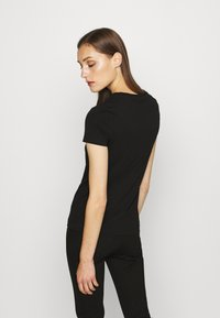 Guess - T-shirt con stampa - jet black