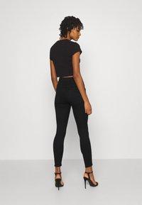 ONLY - ONLROYAL LIFE CORSAGE PIM - Jeans Skinny Fit - black denim - 2