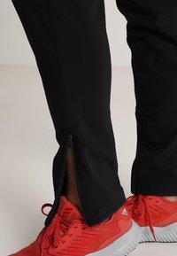 Jack Wolfskin - ZENON PANTS WOMEN - Outdoorové kalhoty - black - 3