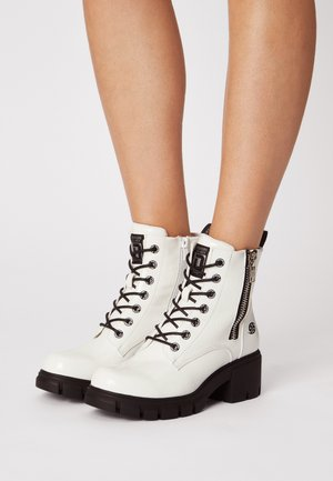 Lace-up ankle boots - weiss/schwarz