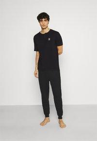 Calvin Klein Underwear - Pyjama bottoms - black - 1