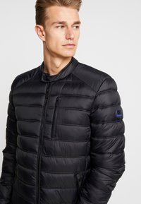 Superdry - COMMUTER QUILTED BIKER - Light jacket - jet black - 3