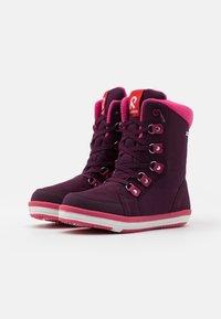 Reima - REIMATEC FREDDO UNISEX - Winter boots - deep purple - 1