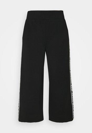 LOGO TAPE PANTS - Trousers - black