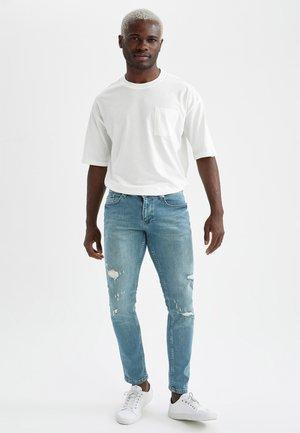 Slim fit jeans - green
