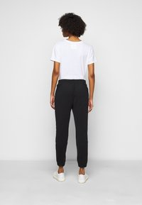 DRYKORN - ONCE - Tracksuit bottoms - schwarz - 2